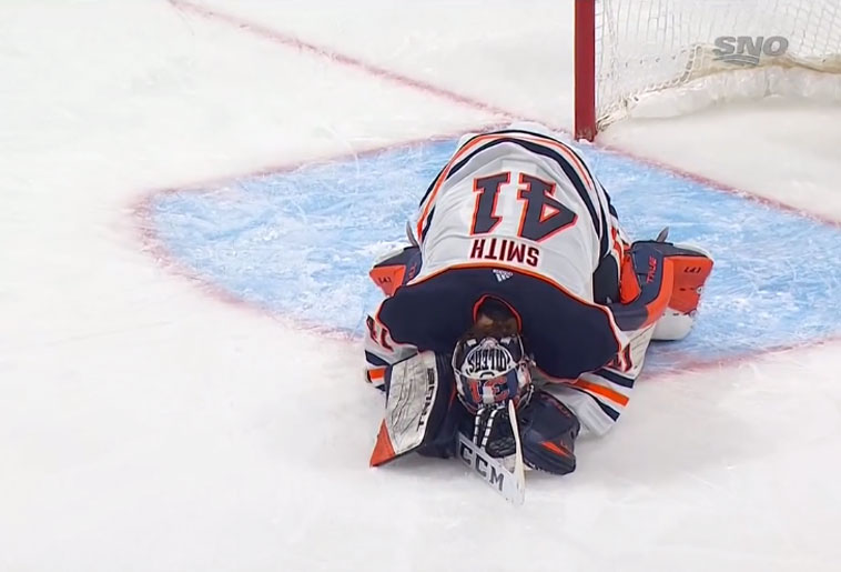 Mike Smith dejected after giving up the game and series winning goal against the Winnipeg Jets in the first round of the 2021 NHL Playoffs.